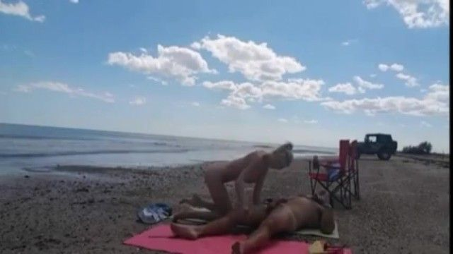 Spouse sharing wife on the beach