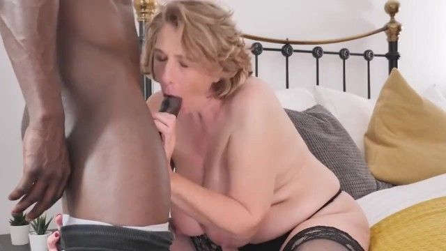 Aged breasty mother tries large dark dick